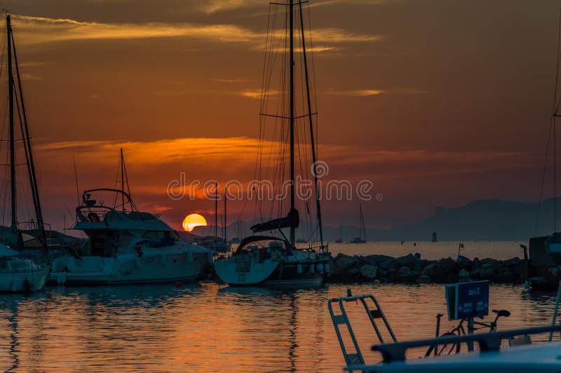 Sunset in a little port in French Riviera. Cote d`Azur French Riviera is situated in the southern eastern part of the mediterranean coast of France and it is stock images