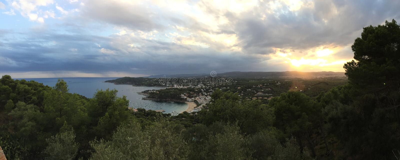 Sunset in Llafranc, costa brava Lighthouse of San Sebastian stock image