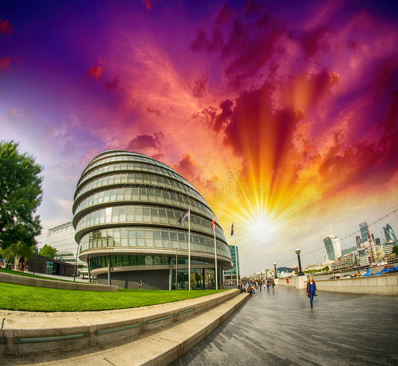 Sunset in London. City Hall area with promenade along River Thames.  stock photos
