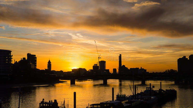 Sunset London Silhouette next to Albert Bridge royalty free stock image