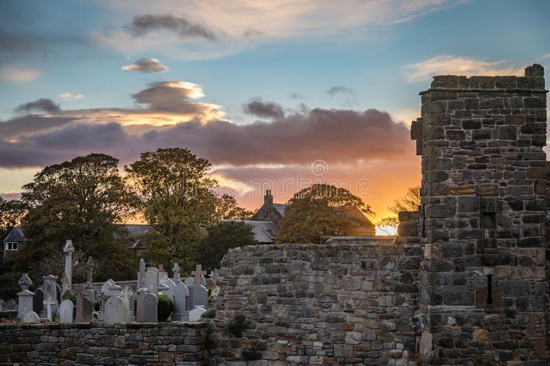 Sunset looking toward the graveyard of St Andrews Cathedral in Fife, Scotland, United Kingdom stock photos
