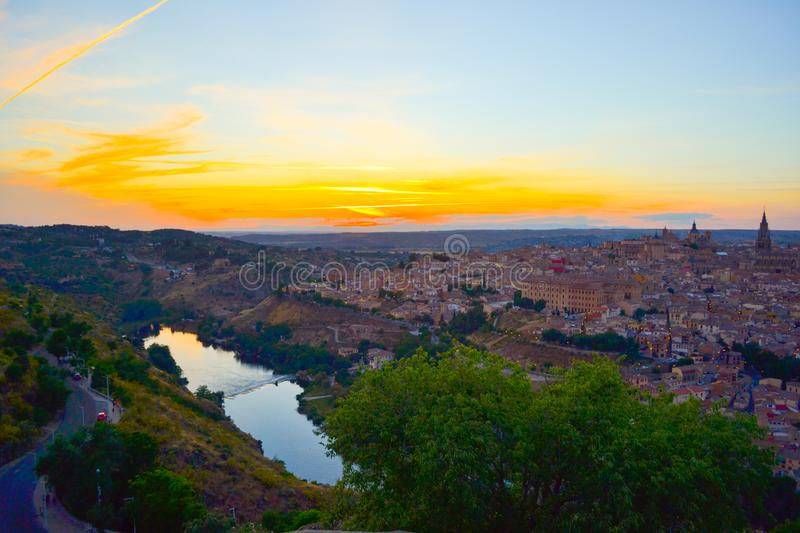 Sunset at lookout of Toledo, Spain. Tajo river around the city and Alcazar and Cathedral at background. royalty free stock images