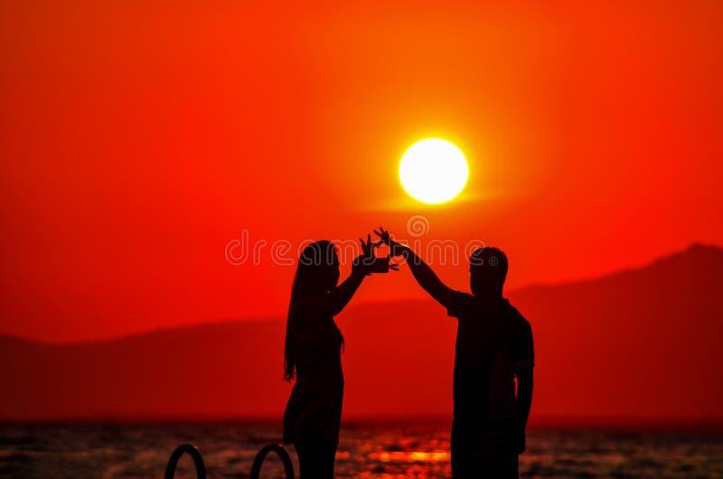 Turkey izmir sunset lovers silhouette heart stock image