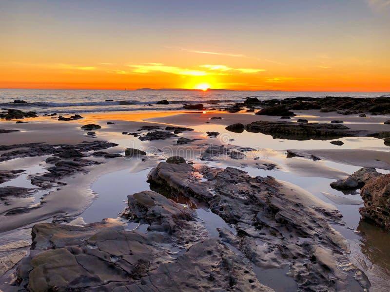 Sunset low tide Crystal Cove beach Newport Beach California royalty free stock image