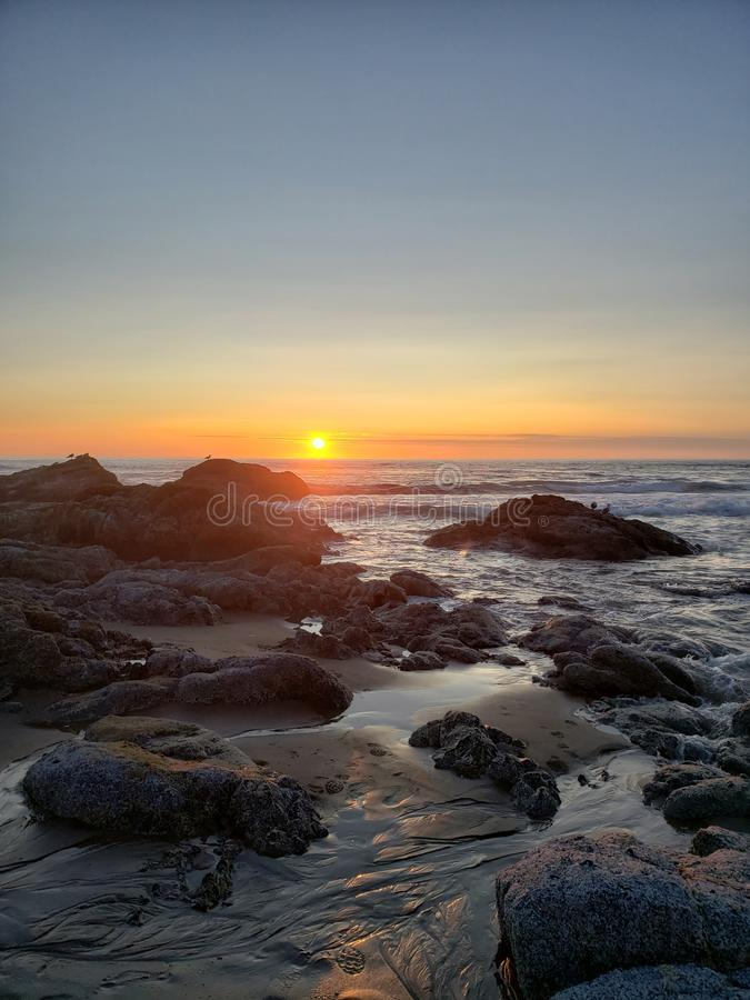 Sunset lincoln city, oregon. Sunset low tide 15th street lincoln city royalty free stock photos