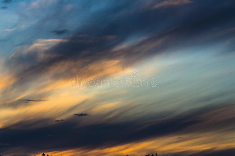 Surreal sky colors over a Swedish lake. A sunset is always a magical moment but when you add some clouds to it, the results can become simply breathtaking royalty free stock image