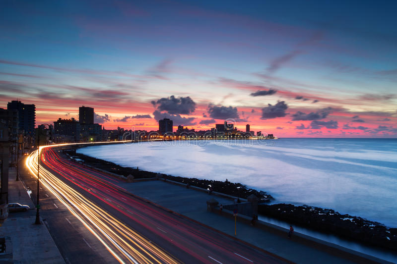 Sunset at Malecon, the famous Havana promenades where Habaneros, lovers and most of all individual fishermen meet, Havana, Cuba stock photos