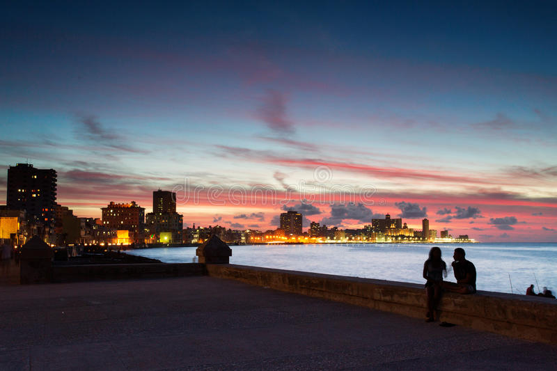 Sunset at Malecon, the famous Havana promenades where Habaneros, lovers and most of all individual fishermen meet, Havana, Cuba stock image