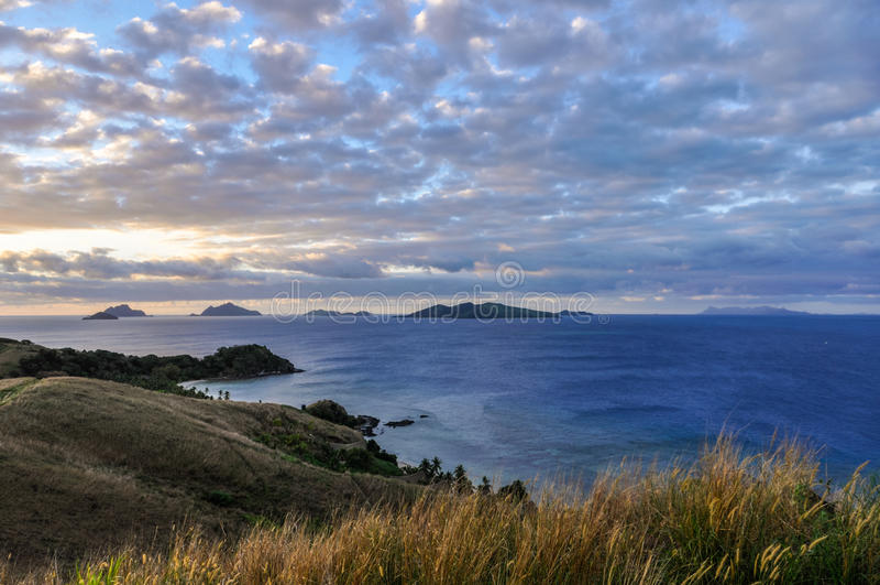 Sunset on Mana Island in Fiji royalty free stock image