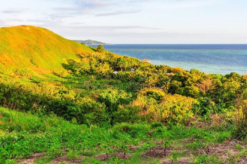 Sunset on Mana Island in Fiji royalty free stock photos