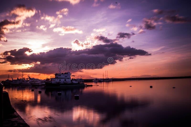 SunSet Manila Bay. Waiting Manila Harbor Square Sunset royalty free stock image