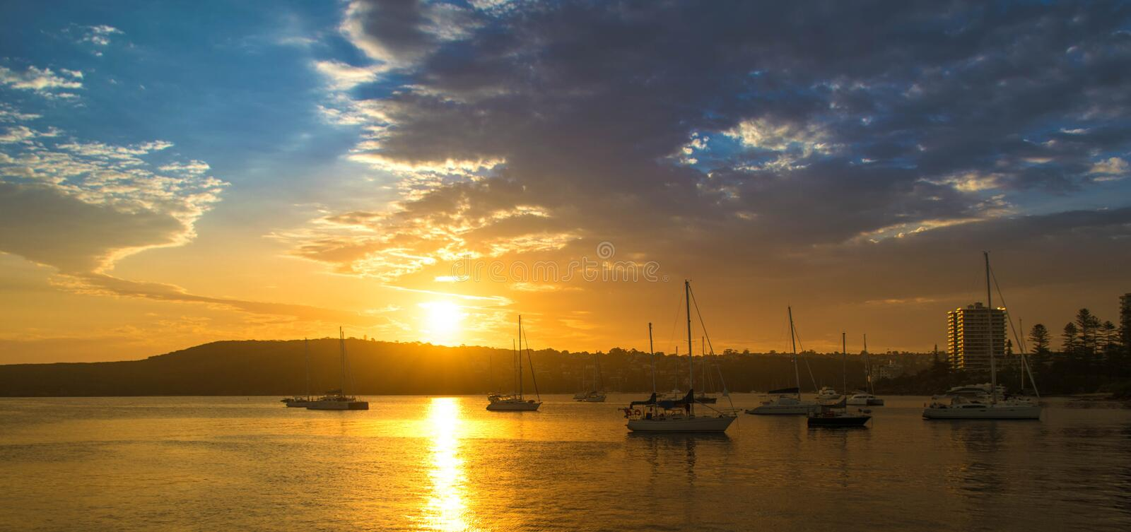 Sunset in the harbour of Manly. Sunset in Manly, just outside Sydney royalty free stock photos