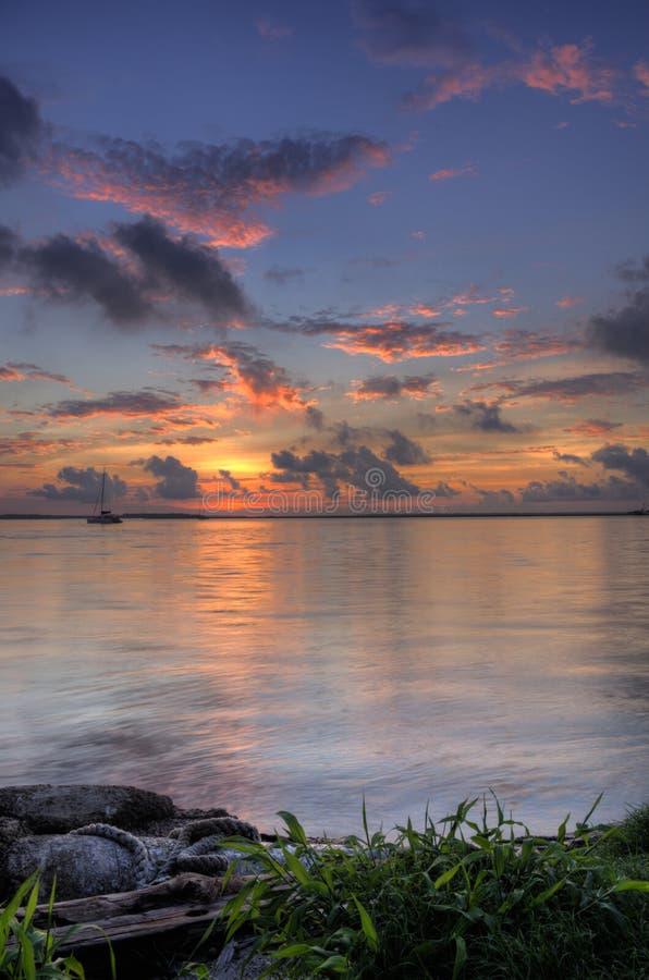 Sunset at marina Fernandina Beach Amelia Island Florida. Sunset, clouds and harbor from the marina on the St. Marys river at Fernandina Beach, Amelia Island stock image