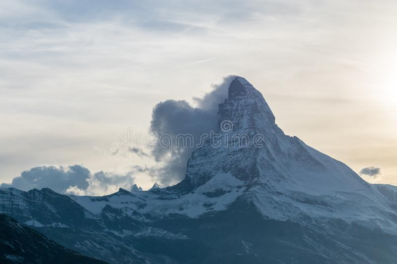 Matterhorn with clouds. Sunset at Matterhorn with reflection in Stellilake in the late afternoon royalty free stock photos