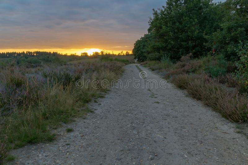 Sunset at the Mechelse Heide with a view of a dirt road. Sunset at the Mechelse Heide English Mechelse meadow with a view of a dirt road, popular area for royalty free stock photography