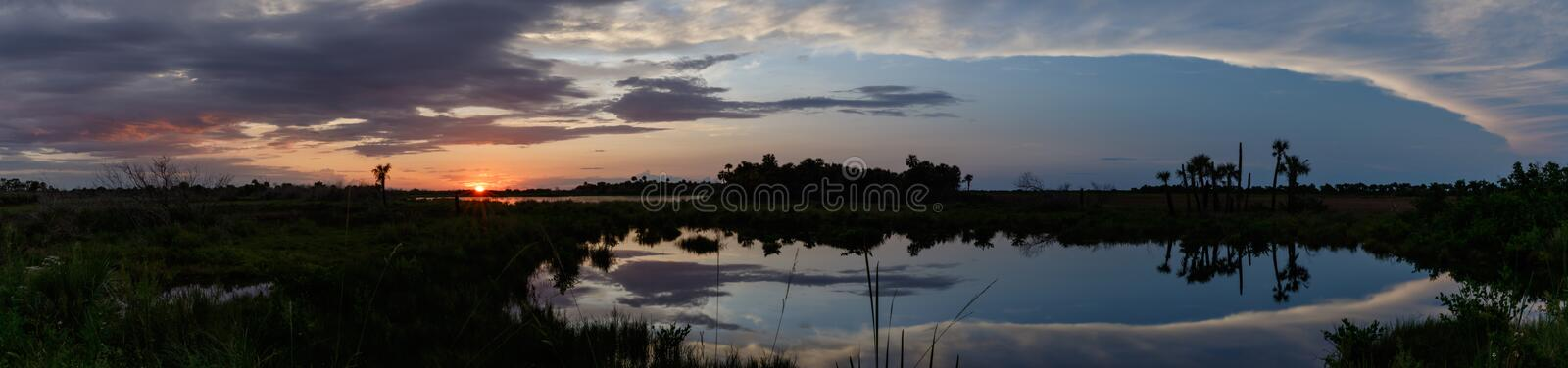 Sunset at Merritt Island National Wildlife Refuge, Florida. Sunset with clouds reflecting in a pond at Merritt Island National Wildlife Refuge, Florida, USA royalty free stock photos