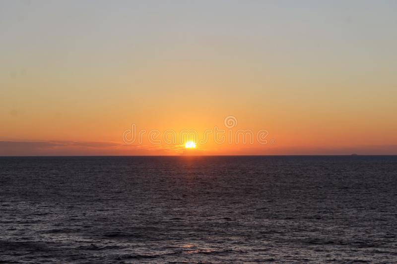 Sunset in the middle of the ocean royalty free stock photo