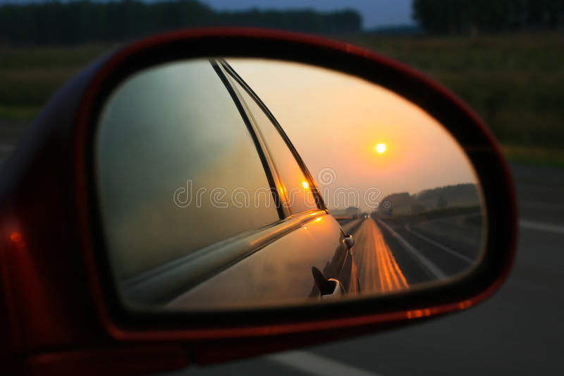 Sunset In Mirror Of Car Royalty Free Stock Images