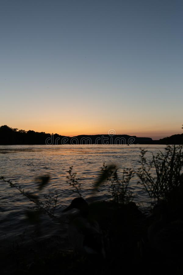 Sunset on the mississippi river in la crosse wisconsin. Viewed from riverbank royalty free stock photography