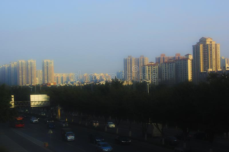 Sunset, modern city, developed traffic, golden sun light royalty free stock photos