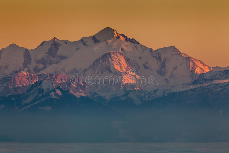 Sunset on Mont Blanc. Sunset colors warming up the world famous Mont Blanc in the Alps stock photo