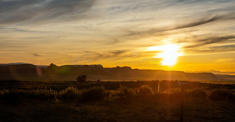 Sunset at Monument Valley Tribal Park in the Arizona-Utah border, USA. Monument Valley at sunset. Navajo Tribal Park in the Arizona-Utah border USA. Sun falling stock photos