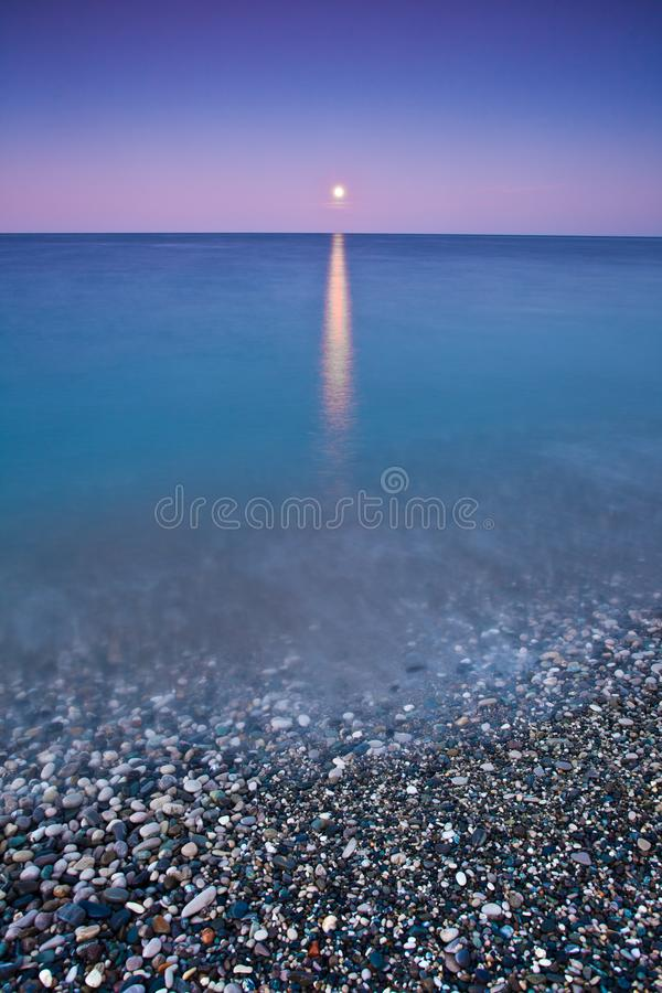 Sunset moon over the sea, surf moonlit path stock photos