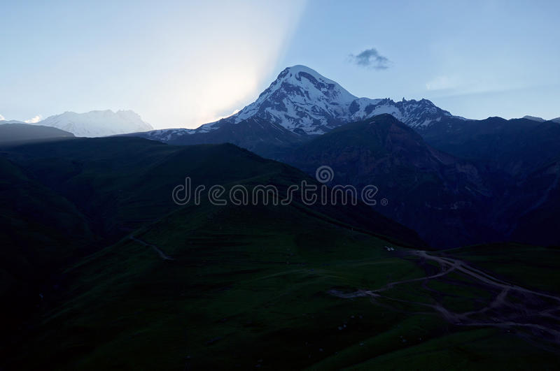 Sunset with mount Kazbek royalty free stock photography