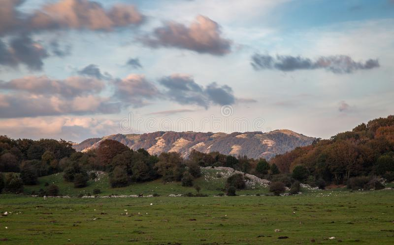 Sunset and Mount Pellecchia, Roma, Italy. Sunset: Blue sky and pink clouds: Monte Pellecchia, Roma, Italy. Parco dei Monti Lucretili royalty free stock photos