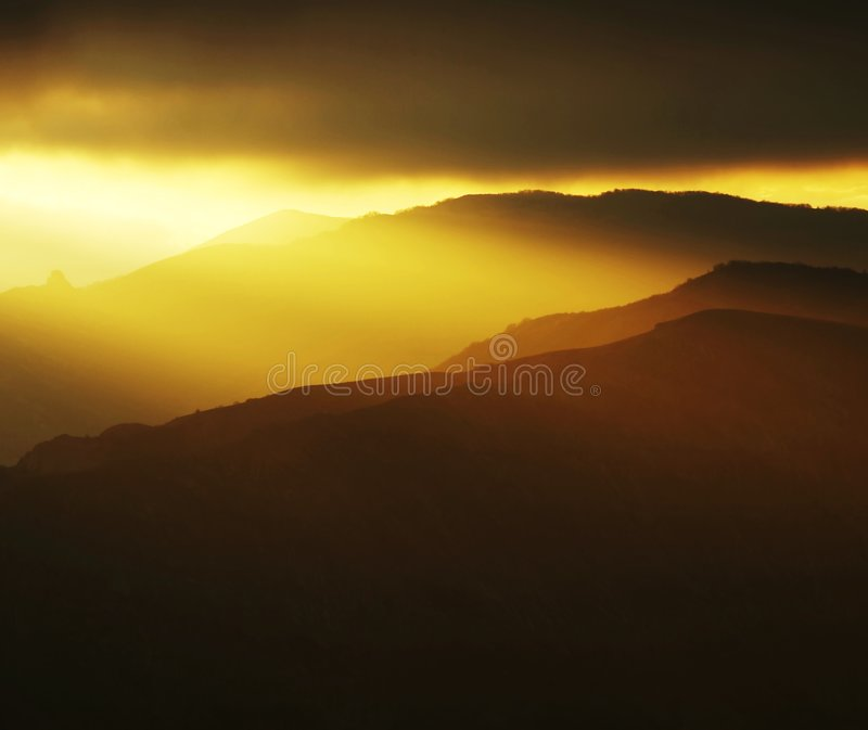 Sunset in mountain. Peaceful sunset in mountain for background royalty free stock photo
