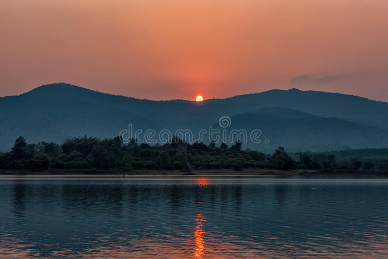 Sunset on mountain lake in Chiang Rai,North of Thailand royalty free stock image