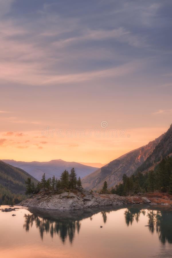 Sunset Mountain Lake With Pink Calm Waters, Altai Mountains Highland Nature Autumn Landscape Photo. Beautiful Russian Wilderness Scenery Image royalty free stock photography