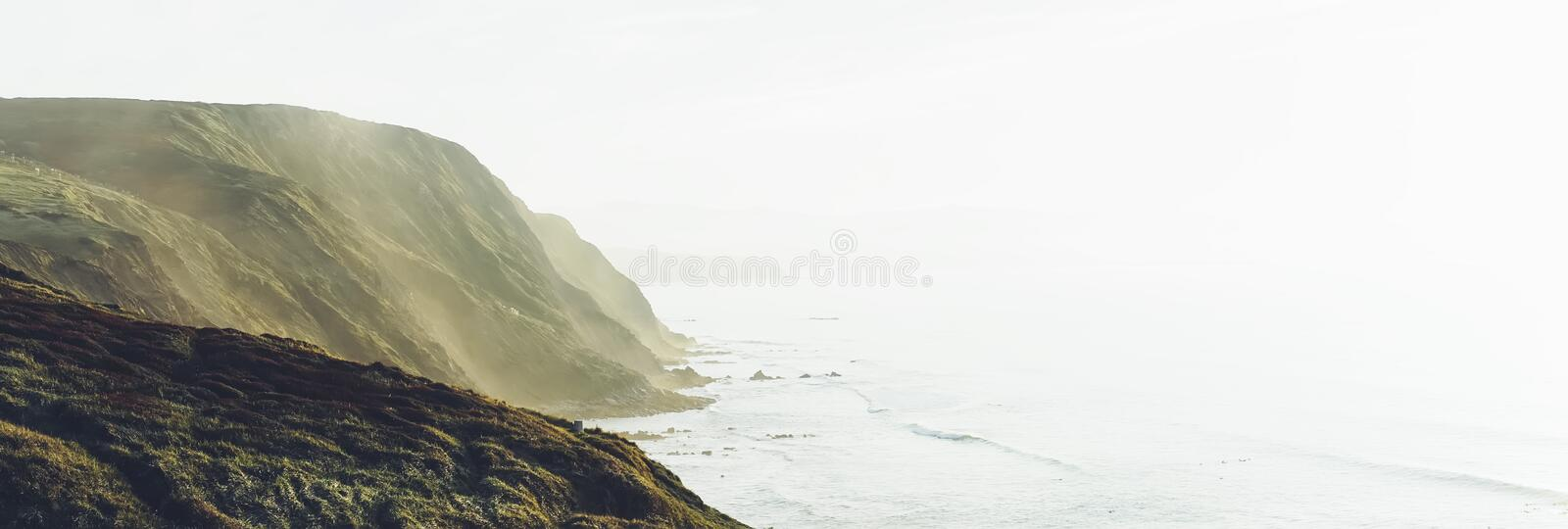 Sunset in the mountain natural landscape. Green valley on background dramatic sky, foggy sea ocean. Panorama horizon perspective royalty free stock photography