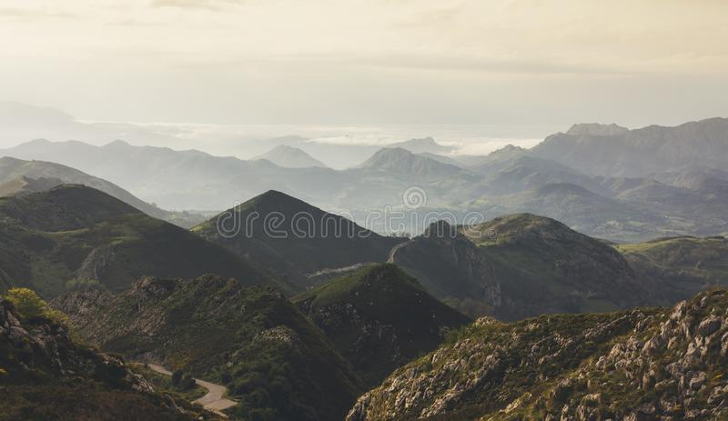 Sunset in the mountain natural landscape park. Green valley on background dramatic sky and clouds. Panorama horizon view of scener royalty free stock image