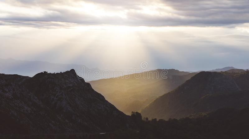 Sunset in the mountain natural landscape park. Green valley on background dramatic sky and clouds. Panorama horizon view royalty free stock image