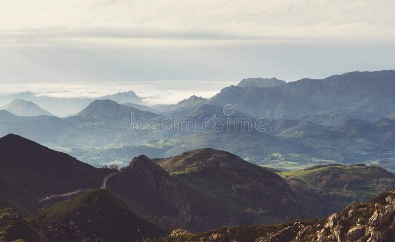 Sunset in the mountain natural landscape park. Green valley on background dramatic sky and clouds. Panorama  horizon view. Of scenery  foggy hills Northern stock image