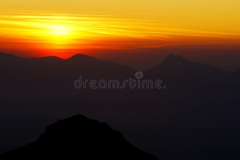 Sunset on mountains. Vith silhouette of moutains stock photos