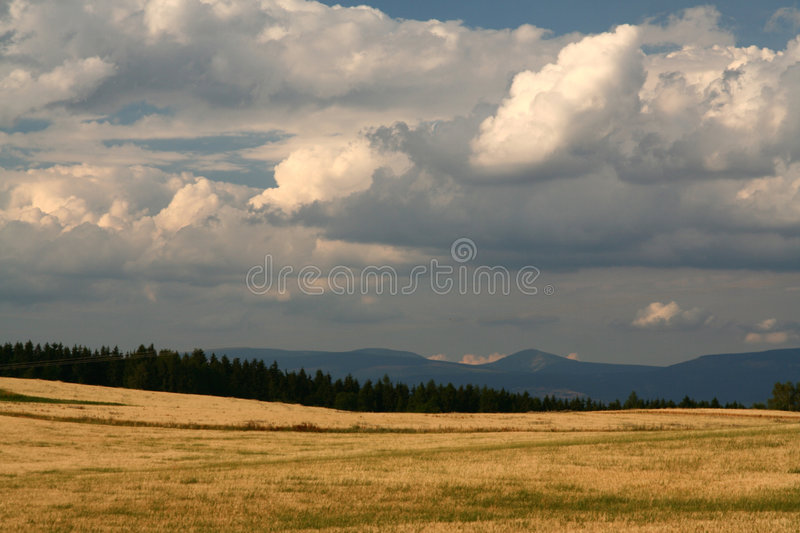 Sunset on mountains. Dramatic clouds (sunset on mountains royalty free stock image