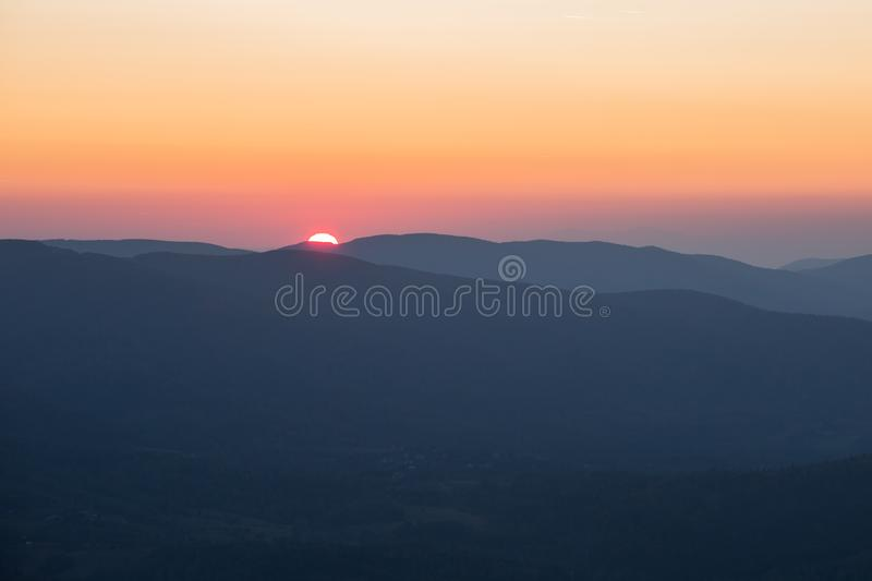 Sunset in the mountains stock photos
