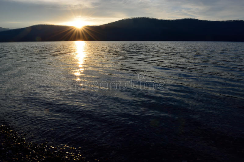 Sunset into the Mountains at McDonald lake in Glacier National Park royalty free stock photography