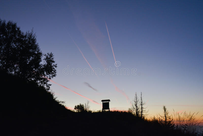 Sunset in the mountains. A sunset over a mountain guidepost stock image