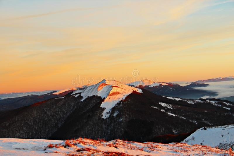 Sunset in the mountains. In Polish Bieszczadach mountains a peak is one of the most recognizable massifs Polonina Wetlinska. A visible peak is Polonina Carynska stock photo