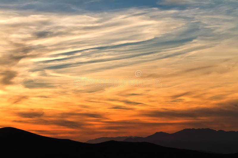Sunset in mountains with sunbeams royalty free stock image