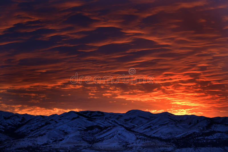 Sunset with Mountains in Wilderness Sky Clouds. Clouds in sky wilderness sunset or sunrise mountains royalty free stock images