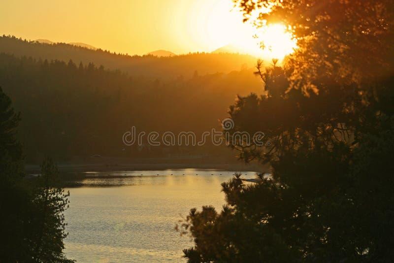 Sunset on a mountian lake stock image