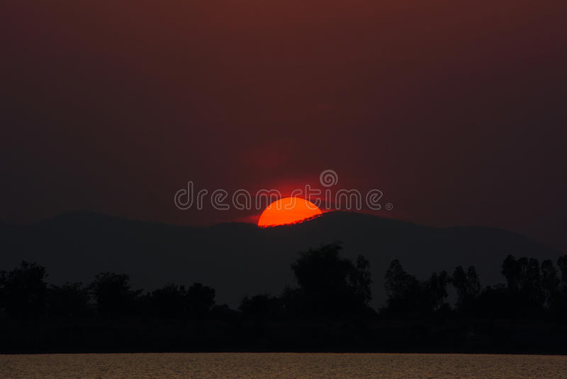 Sunset at the moutain,silhouette trees in foreground. Landscape with sunset at the moutain,silhouette of trees in foreground.Background concept,Natural stock images