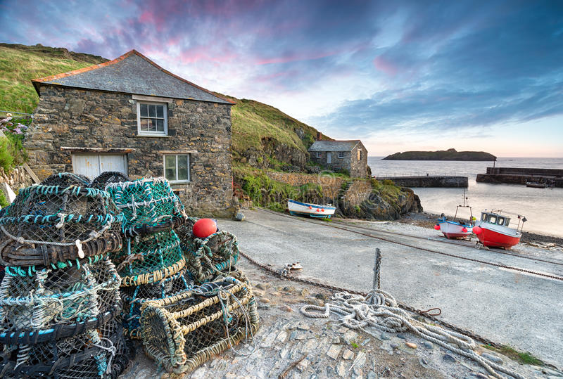 Sunset at Mullion Cove. A small fishing village on the Lizard Peninsula on the Cornwall coast stock photos