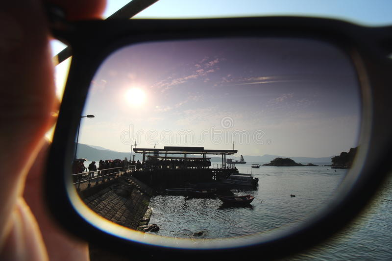 The sunset in my eyes. Using my sunglasses as a CPL filter taking the sunset royalty free stock photography