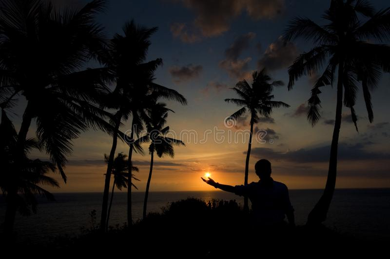 A Sunset in my hand, Lombok Island Indonesia royalty free stock image