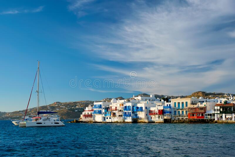 Sunset in Mykonos, Greece, with cruise ship and yachts in the harbor royalty free stock images